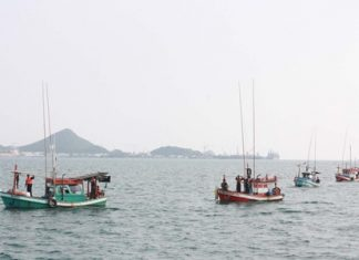 Navy officials bring in the boats illegally stocked with Cambodian fishermen.