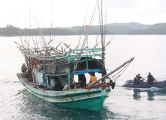 The Royal Thai Navy guides one of two illegal Vietnamese fishing boats into the harbor.