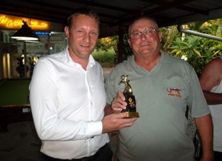 Greg Hirst (left), the sponsor from DeVere Financial Group, presents Andy Makara with the winning Medal trophy.