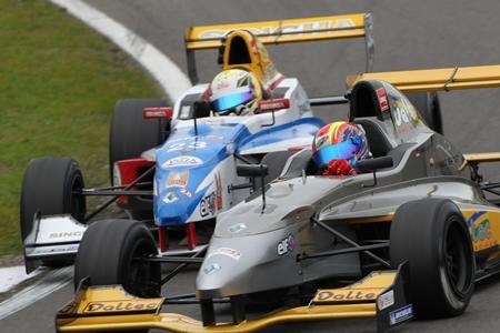 Sandy Stuvik, left, battles for position in the season ending races in Belgium, Sunday, Oct. 14.