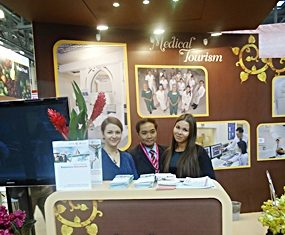Neil Maniquiz (center), head of Bangkok Hospital Pattaya's international marketing department, promotes medical tourism at the Moscow Autumn Travel Industry Week.