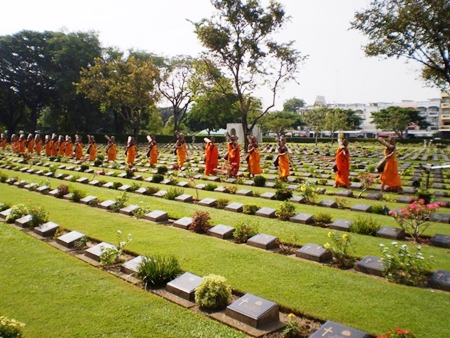 Buddhist monks bless all the graves before our Remembrance Service.