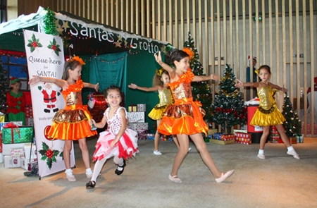 Young angels perform in front of Santa's Grotto.