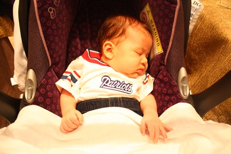 A future Patriots' fan rests up during the busy proceedings.
