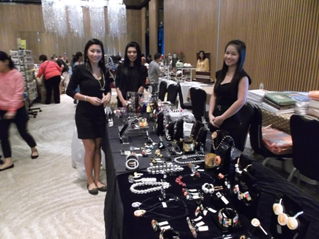 Jewelry vendors display their beautiful wares.