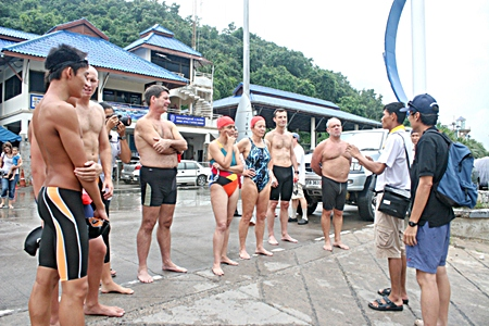 Pattaya sea-rescue officers explain markers and routes before the long distance swim.