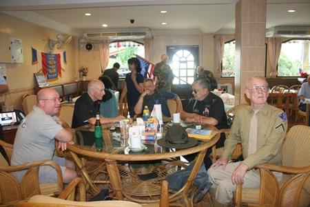Members enjoy coffee and beer among family and comrades.