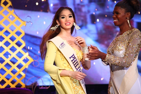First runner-up Jessika Simoes of Brazil (right) applauds Kevin Balot after the later was announced winner of the Miss International Queen 2012 contest.
