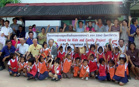 Rotarians from Japan, Australia, USA and Thailand hand over a library during this ceremony.