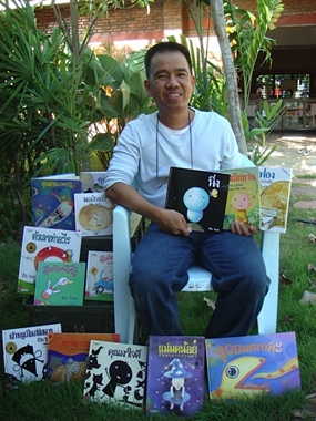 Famous author Cheewan Visasa shows off his collection of children's books.