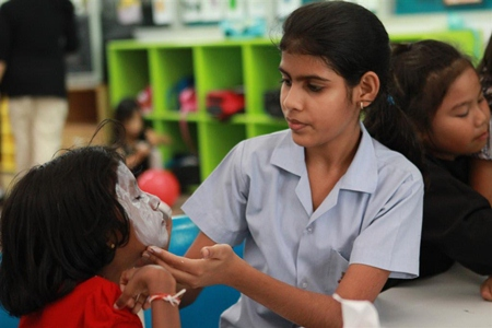 Secondary students helped primary with their face-painting.