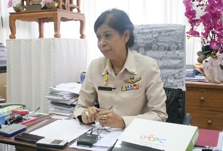 Jintana Maensurin, director of the Pattaya Education Office, with one of the new tablet computers front right on her desk.