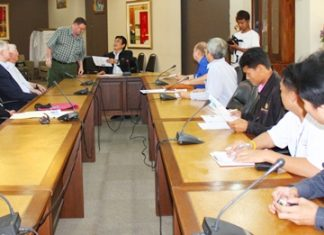 Rotarians and safety officials meet with Deputy Mayor Ronakit Ekasingh to plan out this year's Rotary Cross-Bay Swim.