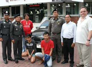 Sunisa Kerdnaikaew and Rungroj Osha (on knees) have been remanded to custody for stealing Michael Procher's (right) BMW.