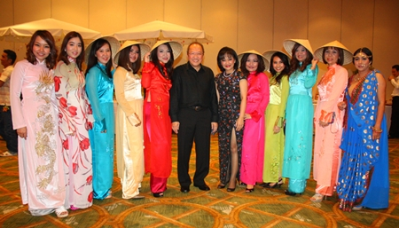 Chatchawal Supachayanont (center) poses with employees dressed in their Vietnam National Costumes.