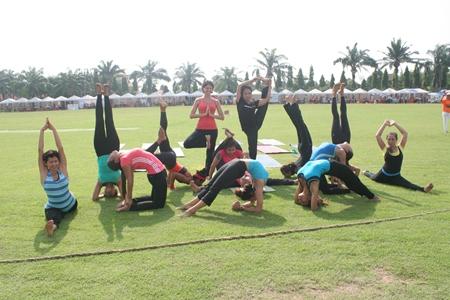 The Pattaya Yoga Club demonstrates various yoga techniques.