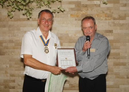 Carl Dyson, President of the Rotary Club Eastern Seaboard (left), is presented with a cheque for 100,000 baht.
