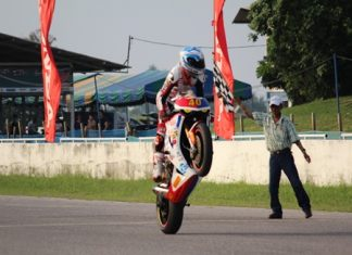 Ben Fortt pulls a wheelie in celebration as he crosses the finish line to win round 9 of the SB-2 Superbike championship.