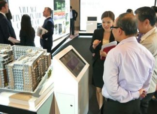 Buyers and investors view the Fitzroy Place exhibit in Bangkok.