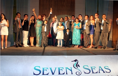 Sonia Punjabi (5th left) and Rajesh Punjabi (6th left) pose with fellow directors, sponsors and VIP's on stage to welcome party attendees at the launch of Seven Seas.