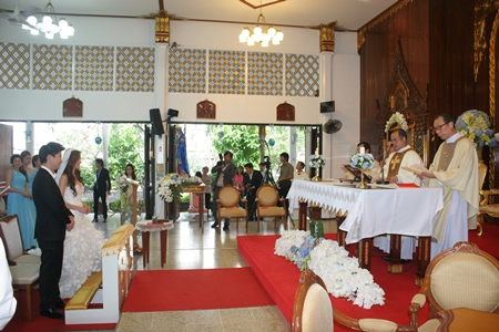 Revered priests celebrate mass in preparation for the wedding ceremony.