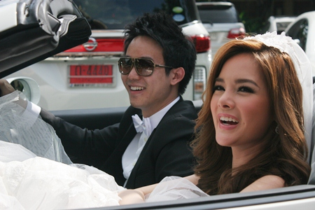 The happy couple makes their way to the church in a white Ferrari.