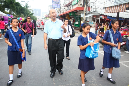 Mr Condom himself, Mechai Viravaidya marches in the parade with students from his new Mechai Pattana School & Kelly Lifelong Learning Center at the Birds & Bees Resort in Pattaya. <http://mechaifoundation.org/school_birdsbees.asp>