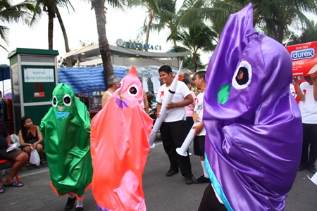 Condom mascots dance their way down Beach Road.