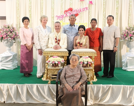 The newlyweds are joined by their respective families for a group photograph.