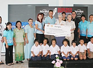 Members of the Eglis family present a 300,000 baht donation to sponsor the project.