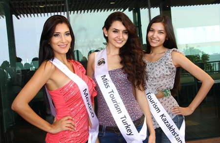 Miss Mexico, Miss Turkey and Miss Kazakhstan pose for a memorable photo.