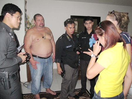 Alexander Matusov (2nd left) tries to explain to police what happened.