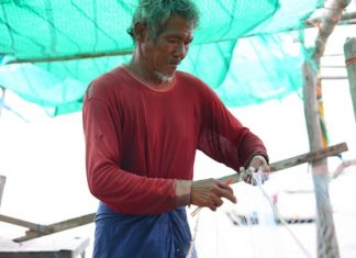 Local fishermen are experts in the ancient art of net repair.