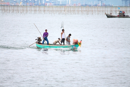 Fishermen return from the sea.