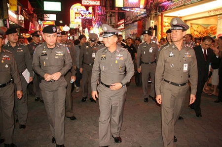 Gen. Adul Saengsingkaew (2nd right) tours Walking Street with local commanders and officers.