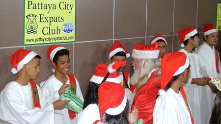 Saint Nicholas (in red cap) popped in to spread some cheer amongst the fine children of the orphanage. Pattaya City Expats Club congratulates Toy and her staff for the great work done with these formerly underprivileged children.