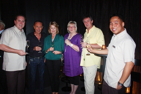 (L to R) Hilton Pattaya Hotel Operations Director Gerard Walker, Michael and Diane Barker, Kristine and Darryl Gretgrix, and Hilton Pattaya Marketing Communications Manager Dhaninrat Klinhom.