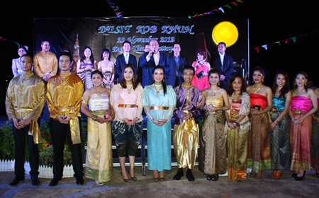 Hotel General Manager Chatchawal Supachayanont (back row 4th from right), is seen with the resort management including the entire sales team as they welcome corporate clients to the Dusit Kob Khun (Thank You) Party held at The Point, the hotel's extended terrace overlooking Pattaya Bay.