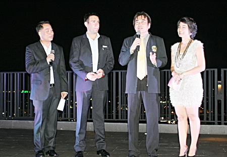 "(L to R) Dhaninrat Klinhom, Philippe Kronberg and Umaporn ""Poo"" Rachatawattanagul listen to Deputy Mayor Ronakit Ekasingh's (2nd right) welcome speech."