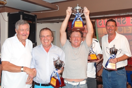 Paul Smith (center) celebrates as captain of the winning team in the John Preddy tournament and Golfer of the Month for November.