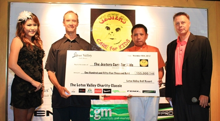 Lewis Underwood (2nd left) accepts a cheque on behalf of the Jesters Care for Kids for money raised by the Lotus Valley Charity Classic.