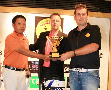 Mike Moir (right) receives the Low Gross trophy after shooting a bogey-free 70.