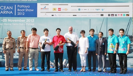Dignitaries and event organizers pose for a group photo at the opening of the first Ocean Marina Boat Show.