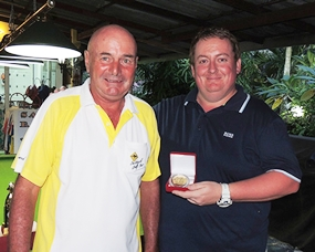 Mark McDonald (right) collects his third low gross medal (Aug, Sept & Nov) from Capt' Steve.