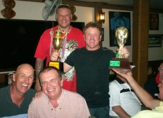 "New champion Paul Smith (with trophies) celebrates with the runners up and ""The Boss""."