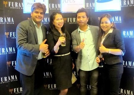 Pattaya Mail's Tony Malhotra (left), Amari Orchid's Dueanpen Thongsombat (2nd left) and Furama's Alissara Khamprachom (right) join to congratulate Chisanucha Phakdeesaneha, CEO of Porch Land Group.