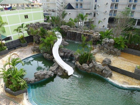 The Cliff project features a huge swimming pool, waterfall and outdoor landscaping.