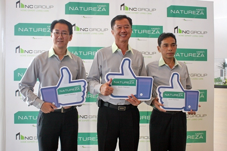 Somchao Tanthatherdthum, Managing Director of N.C. Housing Public Company Limited (center) poses with fellow Directors Somnuk Tanthatherdthum (left) and Rangsankh Nathakawong (right) at a press conference held Jan. 16.