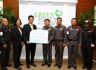 Dr. Pichit Kangwolkij (3rd left), director of Bangkok Hospital Pattaya makes a presentation of 400,000 baht to Pol. Col. Chanapat Nawaluck (4th right), Superintendent of Sattahip Police station to be used for the construction of a Traffic Control Center in preparation for the new year holiday influx of motorists and holiday makers.
