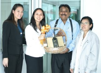 Peter Malhotra, MD of Pattaya Mail Media Group, is elated as he receives a basket of good cheer from Victoria Arnold, PR & Marketing Communications Manager, and Somruthai Chomrat (left), Assistant Marketing Communications Manager from the Royal Cliff Hotels Group with greetings from the top management of the Royal Cliff. At right is Primprao Somsri, Advertising Sales & Marketing Manager of the Pattaya Mail Media Group.